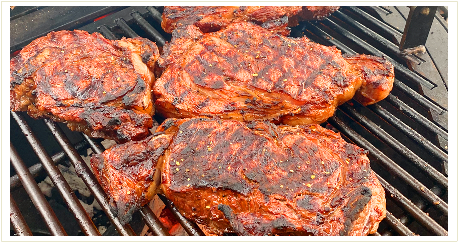 Several steaks being grilled, to the left another image of a gather grill and to the right four people eating food by a gather grill.