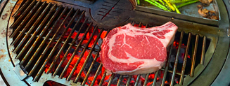 Cooking a raw steak on a gather grill
