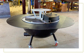 The gather grill combo with the central warming apparatus and hood attached, being displayed