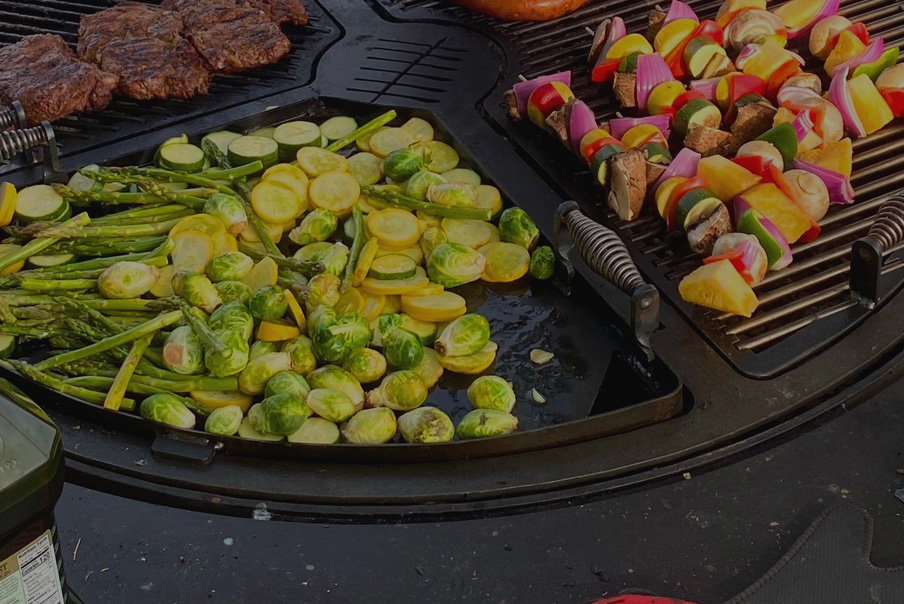Cooking Brussels sprouts zucchini and asparagus on the gather grill.
